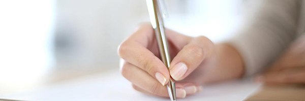 Closeup-of-womans-hand-writing-on-paper